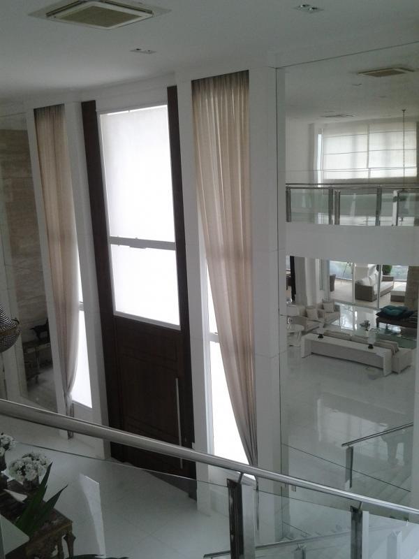 Trilhos motorizados para cortinas